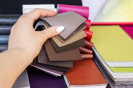 Catalog of multicolored imitation leather from matting fabric texture background, leatherette fabric texture. Industry background. 스톡 콘텐츠
