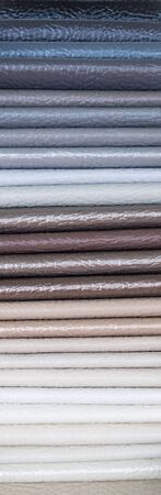 Catalog of multicolored imitation leather from matting fabric texture background, leatherette fabric texture. Industry background. Stock Photo