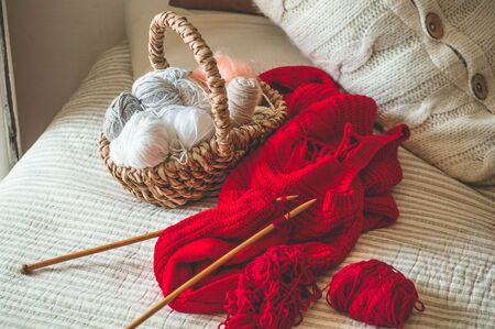 Thread for knitting in a basket closeup. Knitting as a hobby. Accessories for knitting.