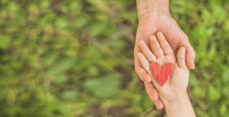 Childs hand and old hand grandmother. Concept idea of love family protecting children and elderly people grandmother friendship togetherness relationship Two generation.