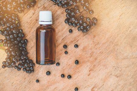 Elderberry syrup immunity boosting for flu season. Elder, black elder. European black elderberry background