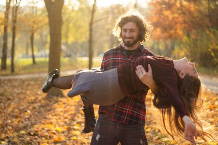 Happy couple outdoors. Outdoor portrait of romantic couple in love. Full of happiness. Valentines Day