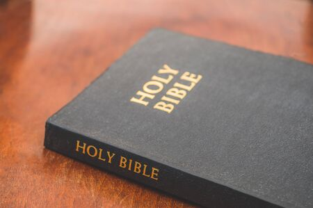 Bible on a wooden background. Concept for faith, spirituality and religion. Peace, hope, dreams concept