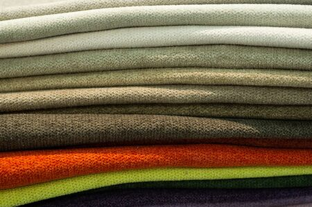 Industry background. Catalog of multicolored cloth from matting fabric texture background, silk fabric texture.