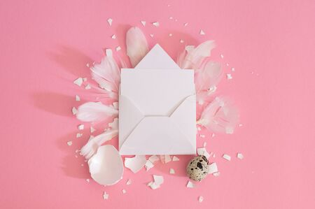 Blank greeting card, kraft envelope. Easter eggs and gypsophila flowers on a pink background. Flat lay, top view. Stock fotó