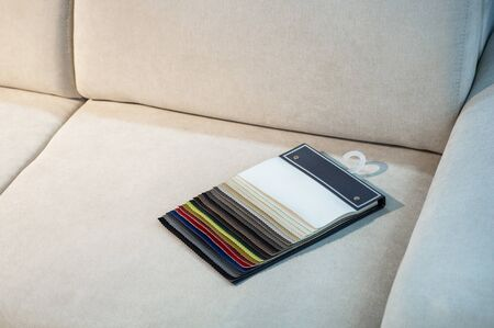 Catalog of multicolored imitation leather. Leatherette samples texture. Industry background.