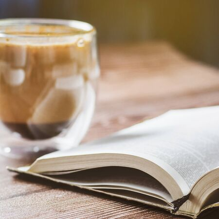 The Bible and cup coffee. Reading the bible.  Concept for faith, spirituality and religion.
