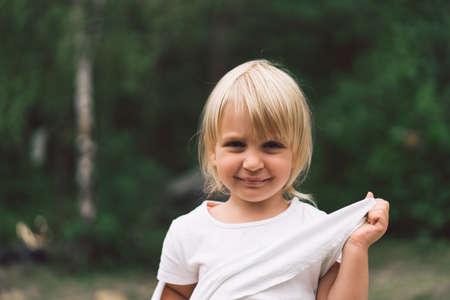 Portrait of a pretty little girl in nature.
