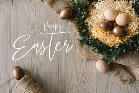 Happy Easter. Easter eggs and and green wreath. Congratulatory easter background. Stock fotó
