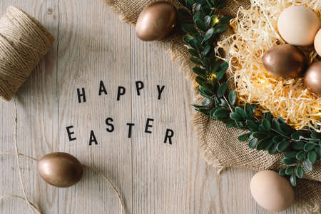 Happy Easter. Easter eggs and and green wreath. Congratulatory easter background.