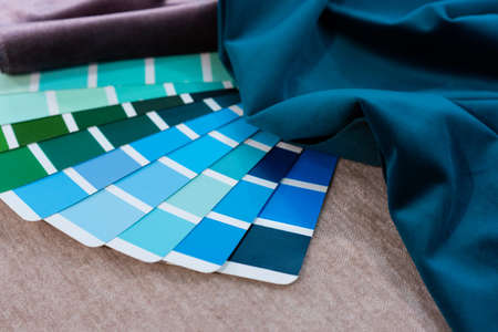 Multi Color guide palette with fabric samples. Repair concept