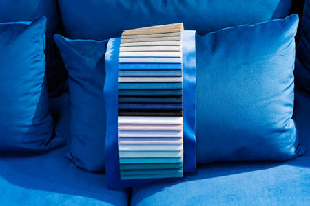 Tissue catalog. Catalog of multi-colored fabric samples. Textile industry background.