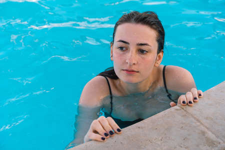 The girl bathes in the pool. Summer vacation and travel. Lifestyle Stock fotó
