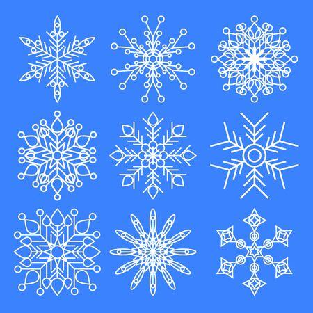 Zestaw świątecznych płatków śniegu na białym tle na niebieskim tle