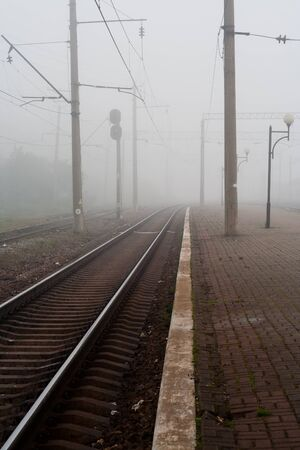 mid distance: Railway in fog Stock Photo