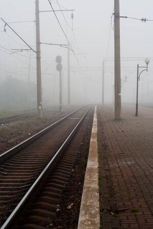 cul de sac: Railway in fog Stock Photo