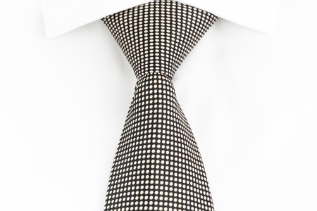 spotted: black and white spotted tie knotted Windsor