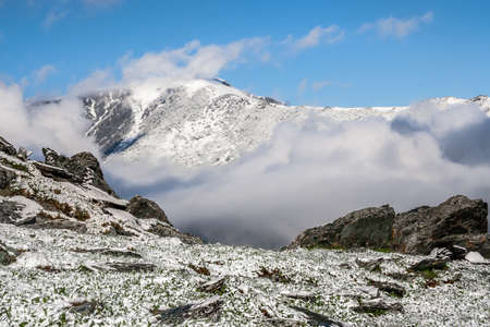 snow-covered slopes of the Altai Mountains and clouds at the horizon