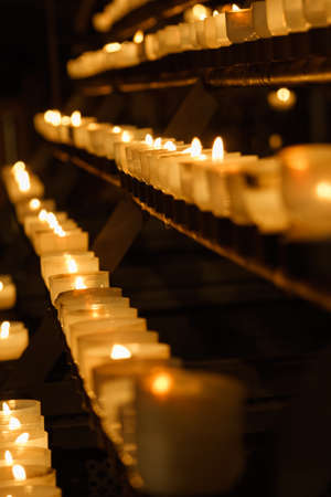 lighted candles in church Stock Photo