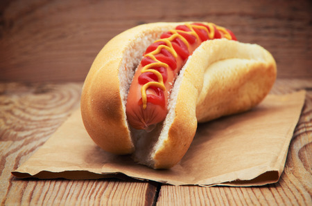 hot dog: Tasty hot dog on wooden table