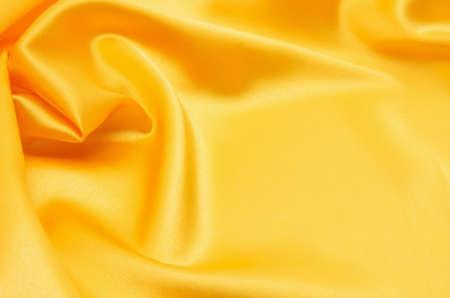 Smooth elegant golden silk Imagens