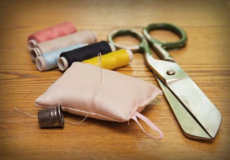 Sewing accessories on wooden table photo