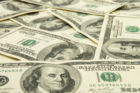 green  pattern: One hundred dollars pile as background. Stock Photo