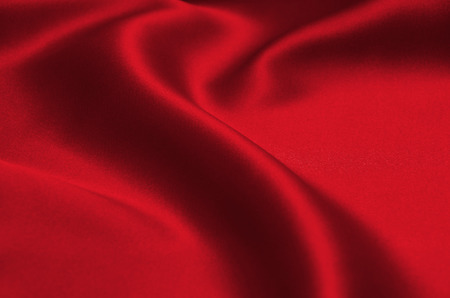 red wave: red satin or silk fabric as background Stock Photo
