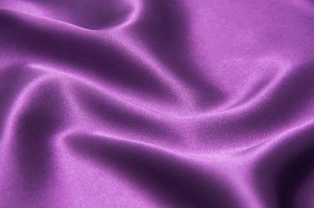 Closeup of rippled purple silk fabric