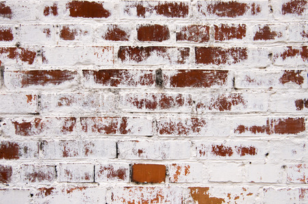 old brick wall texture background with worn off paint photo