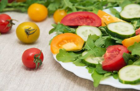 rucola: Fresh salad with tomatoes, rucola and cucumbers Stock Photo