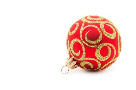 Red christmas ball isolated on a white background. Banco de Imagens