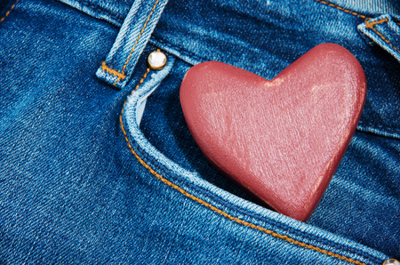 jeans pocket: red heart in jeans pocket Stock Photo