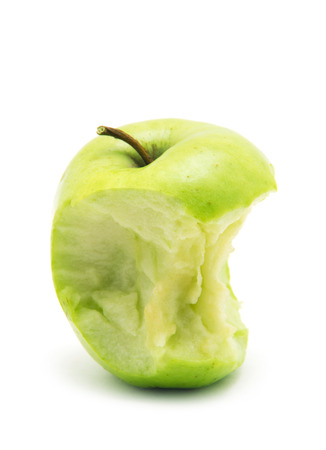 bitten: bitten green apple isolated on white background Stock Photo