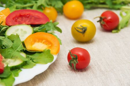 rocket lettuce: Fresh salad with tomatoes, rucola and cucumbers Stock Photo