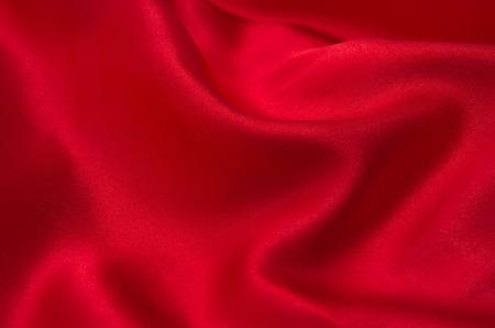 red satin or silk fabric as background Standard-Bild