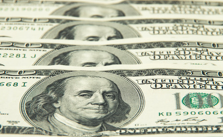 one hundred dollars: One hundred dollars pile as background. Stock Photo