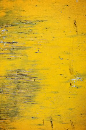 told: Old yellow wooden background