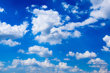 blue and white: blue sky background with white clouds