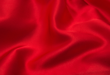 red satin or silk fabric as background Stock Photo