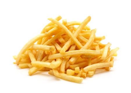 french fried potato: a pile of appetizing french fries on a white background Stock Photo