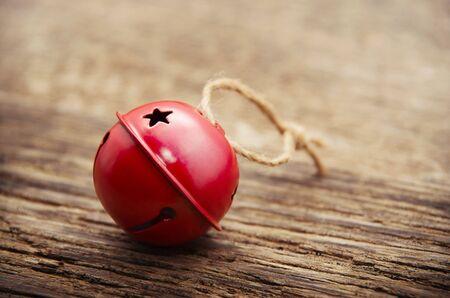 jingle bells: Christmas Jingle bells on a rustic wooden background