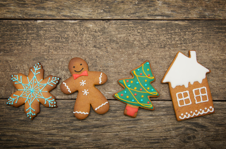 gingerbread cookies: Gingerbread cookies over wooden background Stock Photo