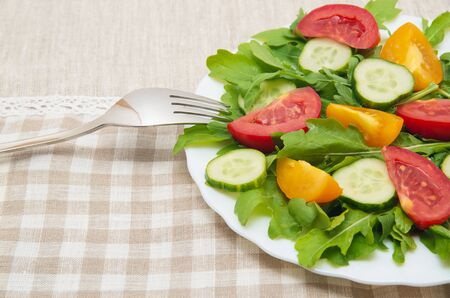 roquette: Fresh salad with tomatoes, rucola and cucumbers Stock Photo