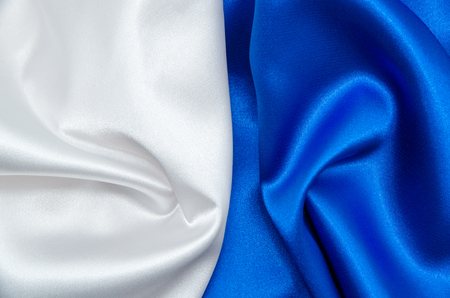 blue satin: white and blue satin fabric for background Stock Photo