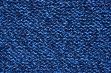 tejido de lana: The texture of a knitted woolen fabric blue. Foto de archivo