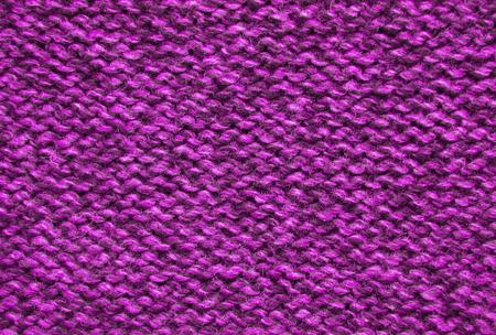 tejido de lana: The texture of a knitted woolen fabric pink.