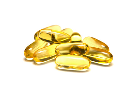 Isolated fish oil capsules Фото со стока
