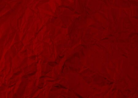 Red crumpled paper texture background.