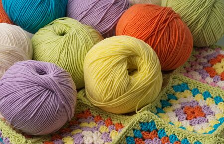 Balls of colored yarn background Banco de Imagens